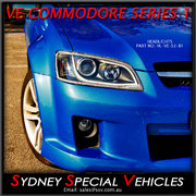 HEADLIGHTS FOR VE COMMODORE SERIES 1 - BLACK DRL WITH CONTINUOUS LED STRIP