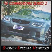 HEADLIGHTS FOR VE COMMODORE SERIES 2 - BLACK DRL WITH CONTINUOUS LED STRIP