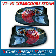 TAIL LIGHTS FOR VT VX COMMODORE SEDANS - ALTEZZA STYLE